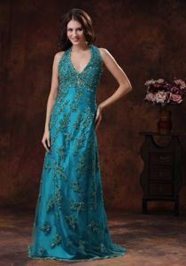 Appliqued Turquoise Brush Train Sparkly Homecoming Dresses with Halter from Metairie