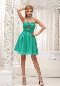 Sweetheart Ruched and Beaded Green Keyhole Empire Homecoming Dance Dress
